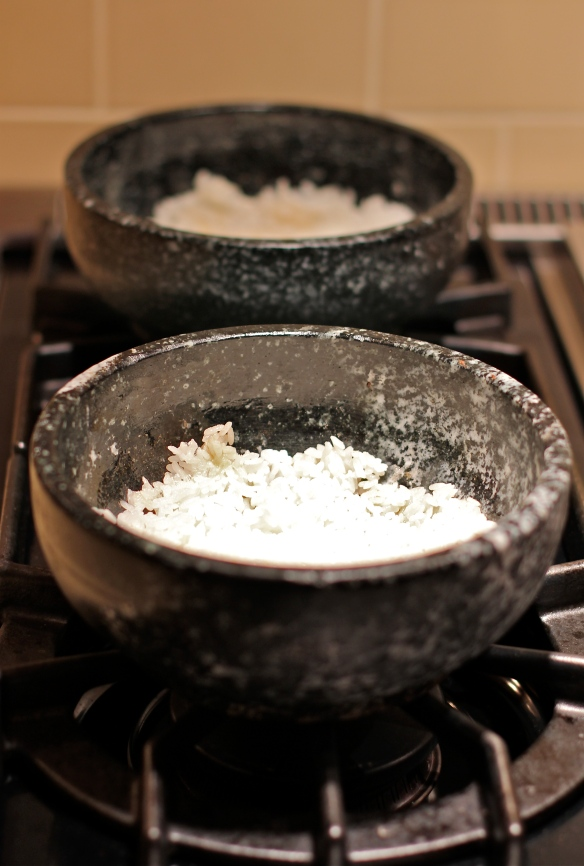 Heated Stone Bowls with Rice Pressed Into Bottom